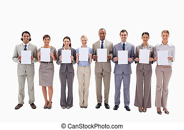 Business people holding white support for letters - Eight...