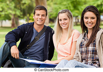 Portrait of students studying together while sitting in a...