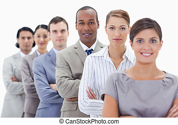 Big close-up of a business team in a single line crossing...