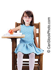 Child at School Desk - Little girl wearing glasses sitting...