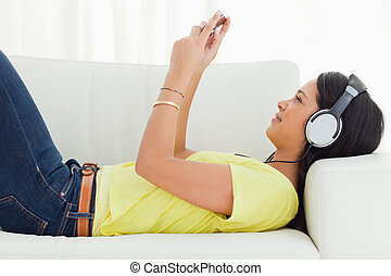 Young Latino woman watching a video