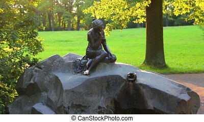 girl with jug statue in Pushkin park St Petersburg Russia
