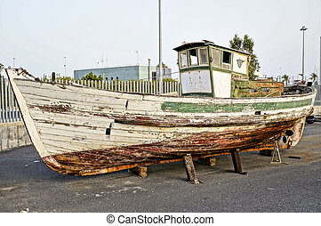 wooden boat - Deserted rusty old and broken wooden boat on...
