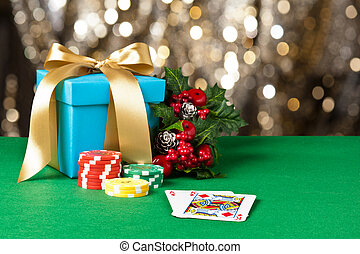 Ace and King in Christmas setting with poker chips