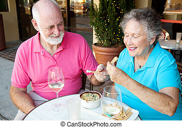 Dating Seniors Enjoy Appetizer - Senior couple on a date...