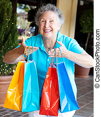 Shopaholic - Compulsive Shopping - Senior woman addicted to...