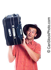 Happy excited man traveller with luggage