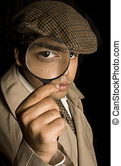 Detective looking for clues through magnifying glass