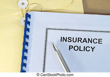 insurance policy folder on desk in office with pen and...
