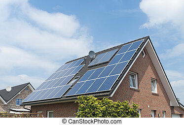 house with solar panels - solar panels on the roof of a...