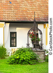 European rural house garden fountain. - Hungarian cottage...
