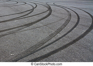 Tire tracks - Rubber tire tracks on pavement