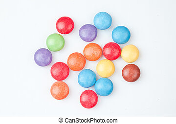 Candies multi coloured against white background