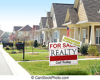 Reduced - View of a residential street and a real estate for...