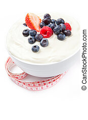 Berries cream with a tape measure