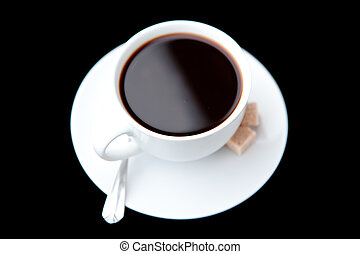 Mug of black coffee against a  black background