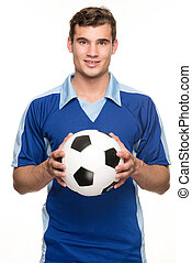 Soccer player - Young soccer player with ball in front of...