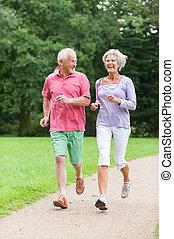 Active seniors - Active senior couple in the park