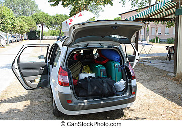 family car of charge luggage ready for departure on holiday