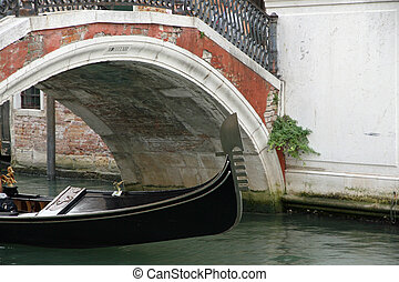 gondola passing under the bridge in Venice