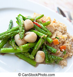 Delicious oriental fried rice with asparagus and scallops.
