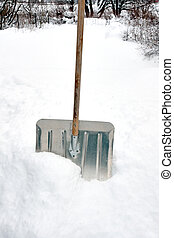 Snow shovel in snow drift after storm