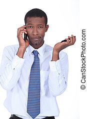 Businessman with cellphones