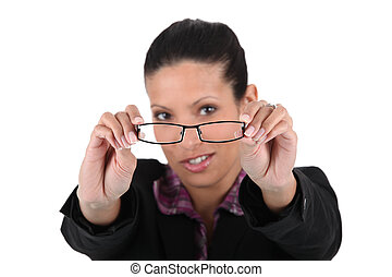 young woman trying her glasses