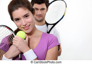Couple dressed for tennis