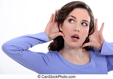 woman listening something carefully