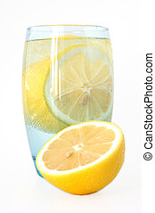 Lemon in water. - Lemon in glass with mineral water and ice.