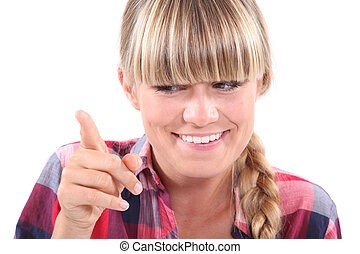 Young woman wagging her finger in a lighthearted manner