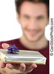 Man holding out a mystery gift