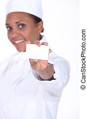 Woman caterer showing business card