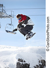 A snowboarder in mid-air