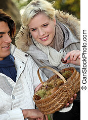 Couple with basket of chestnuts