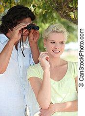 Young couple with binoculars