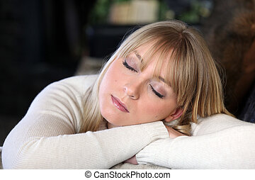 Blond woman snoozing