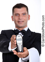 Waiter giving telephone