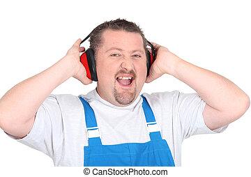 Worker wearing earmuffs