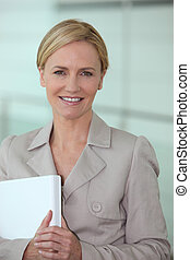 Blond woman carrying computer