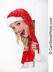 young woman dressed as a Santa Claus