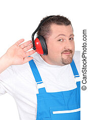 Man wearing ear defenders