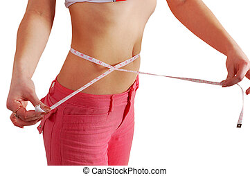 woman measuring her waist with a measuring tape. Path is...