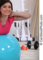 Woman using a gym ball