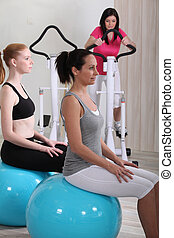 Women sat on gym ball