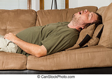 Passed out hard. - Man asleep on the couch with his mouth...