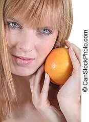 Young redhead with orange