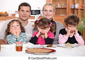 Sulky children with pancakes