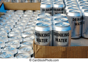 Disaster Relief - Stacks of drinking water cans for...